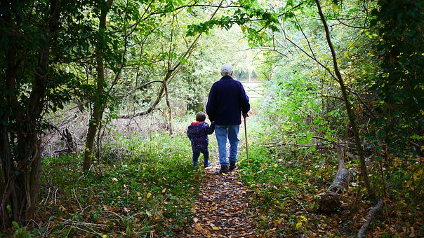 gpa with little boy in woods